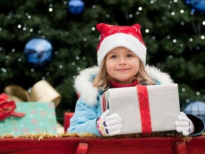 Girl carrying Christmas Gift