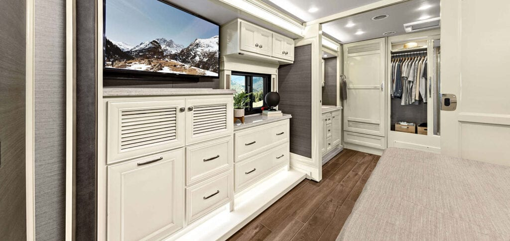 RVs with white cabinets in bedroom
