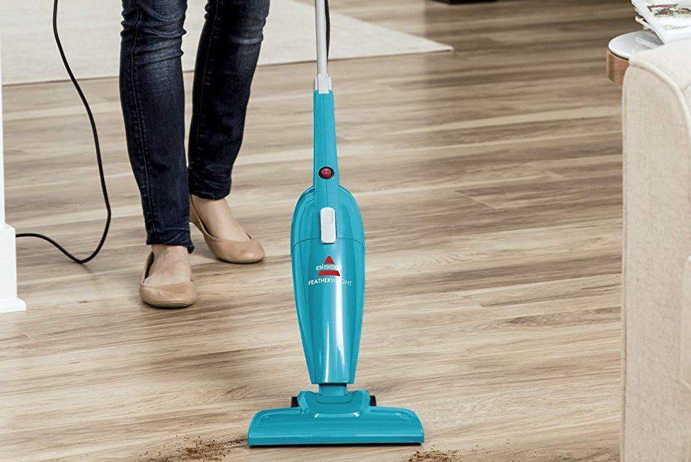 Stick vacuum on hardwood floor