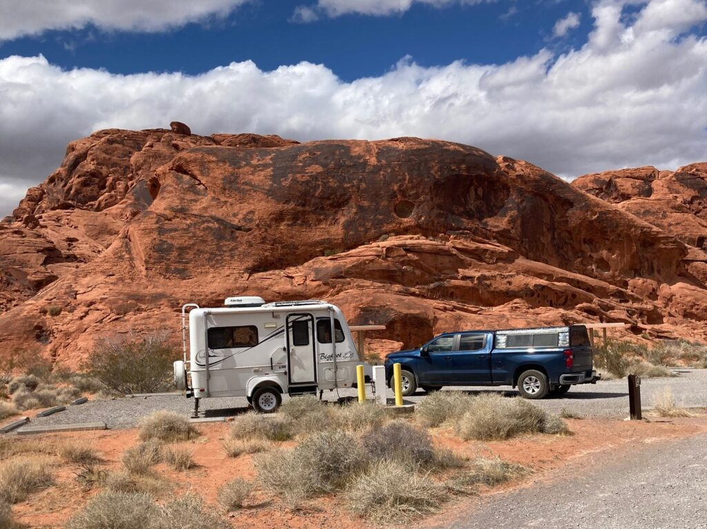 Small Travel Trailer in Campsite Surrounded by Red Rocks