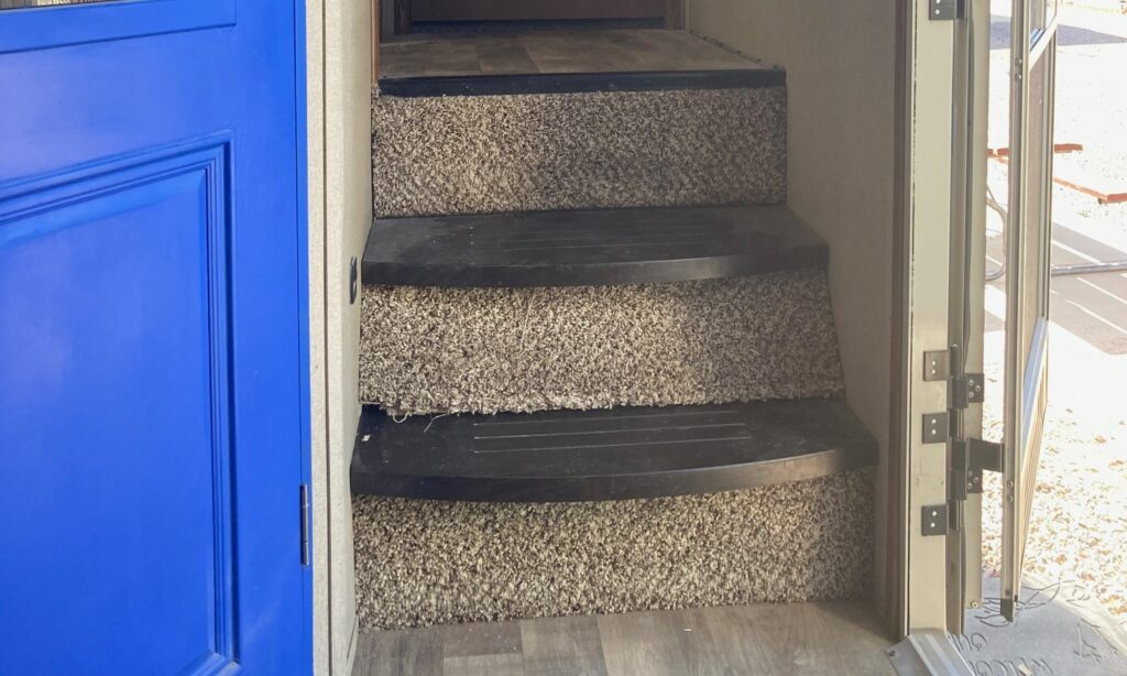RV interior staircase and closet door painted blue