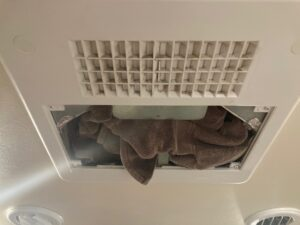 Cleaning RV Air Conditioners: Stuff Towel in Place of Air Filter to Collect Debris